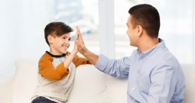 man and child high-five