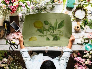 person holding plant painting