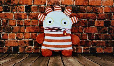 worried fabric puppet with zipper