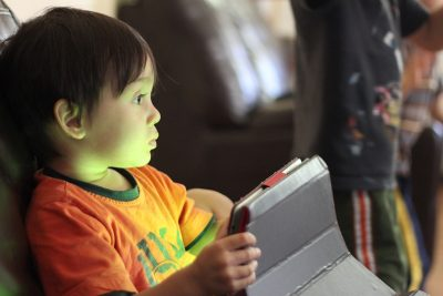 kid absorbed by screen