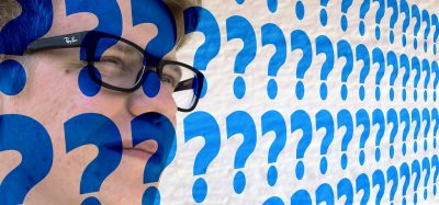 face covered with question marks