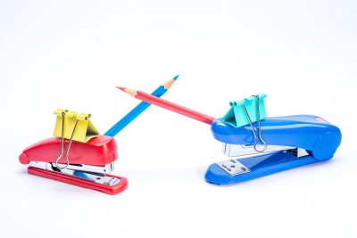 staplers with clip pencils personification war